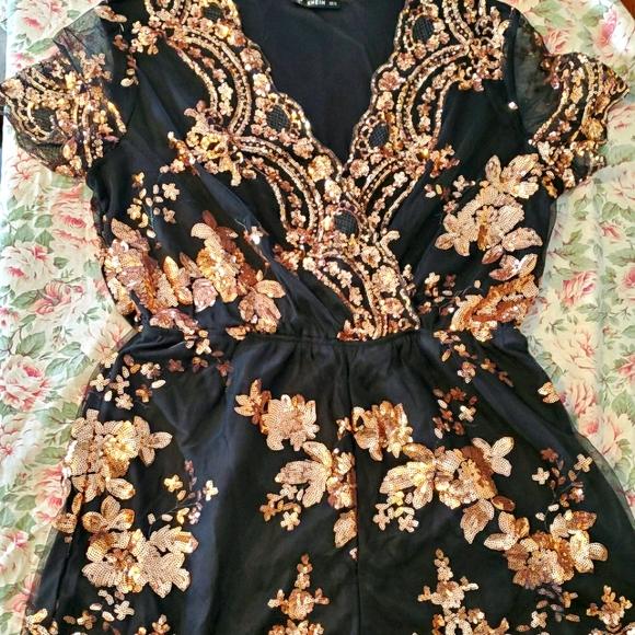 Black and gold sequin romper
